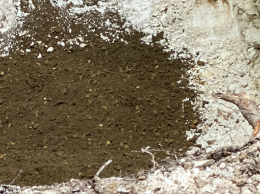 This image shows a layer revealed under a gravel layer.