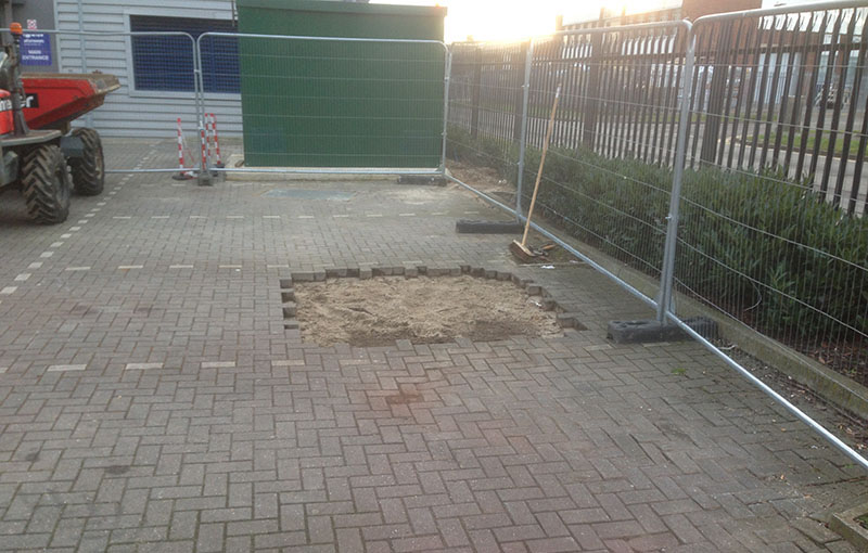 This image shows the trench in the concrete backfilled